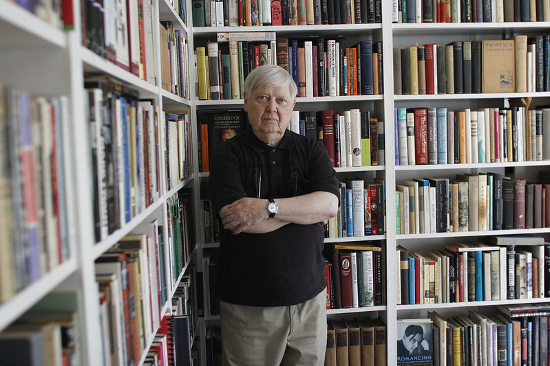 William Gass in his library