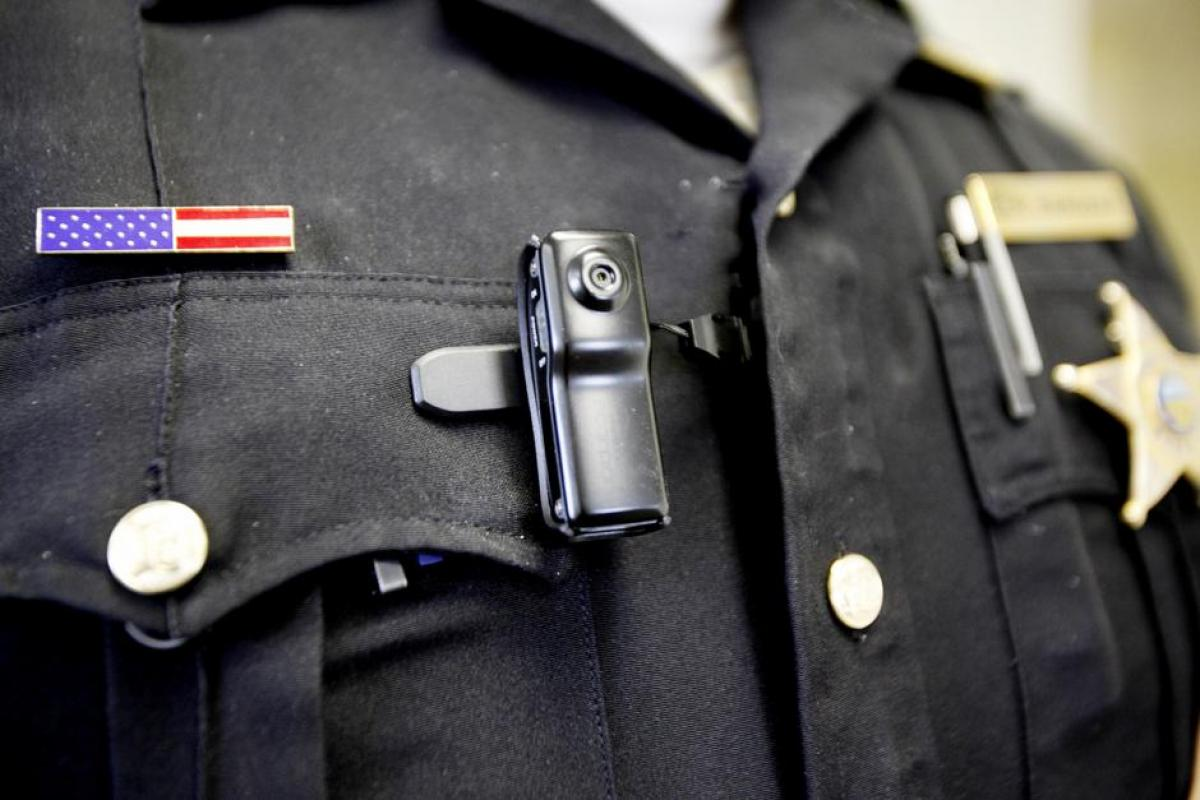 A body camera modeled by a police officer.  The Mantle