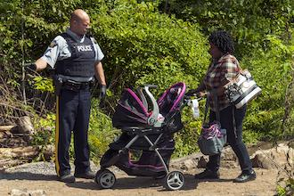 woman stroller child immigration border canada asylum